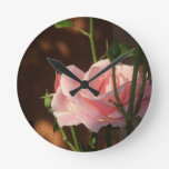 single pink rose in the afternoon wall clocks