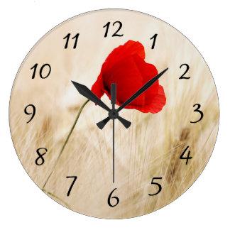 Single Red Poppy in a Grassy Field Clocks