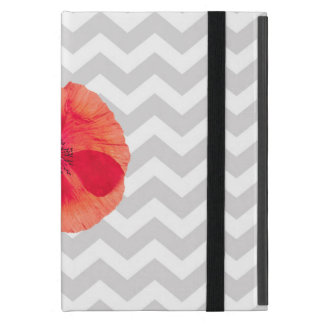 Single red poppy on grey and white chevron pattern cover for iPad mini