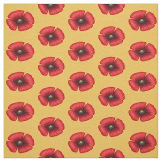 Single red poppy on yellow fabric