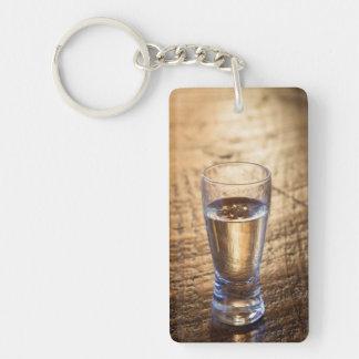 Single shot of Tequila on wood table Double-Sided Rectangular Acrylic Key Ring