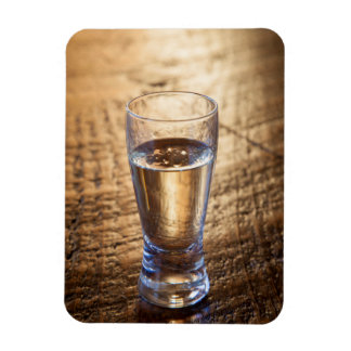 Single shot of Tequila on wood table Rectangle Magnets