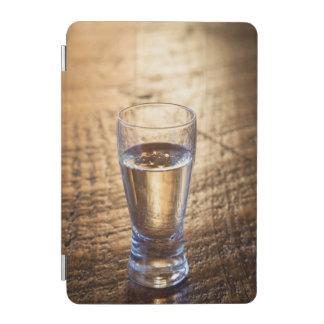 Single shot of Tequila on wood table iPad Mini Cover