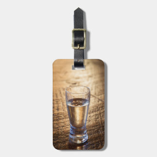 Single shot of Tequila on wood table Luggage Tag