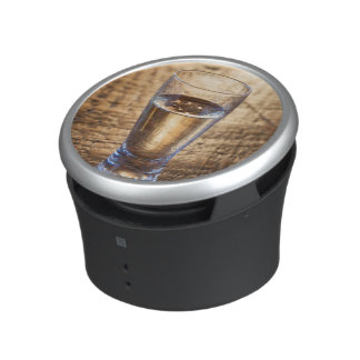 Single shot of Tequila on wood table Speaker