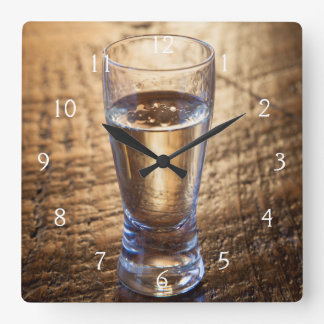 Single shot of Tequila on wood table Square Wall Clock