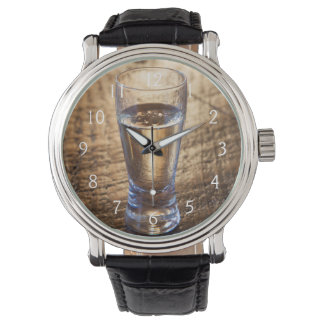Single shot of Tequila on wood table Watch