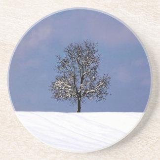 Single Tree In The Snow Coaster