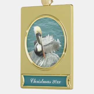 Sitting Pelican Dated Gold Plated Banner Ornament