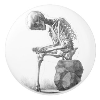 Sitting vintage skeleton thinking knob