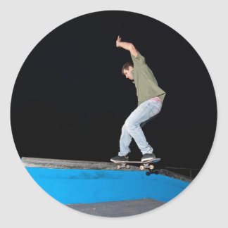 Skateboarder on a slide classic round sticker