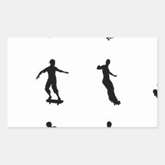 Skating skateboarder silhouettes rectangular sticker