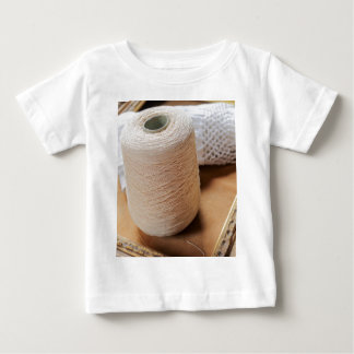 skein of wool and frame baby T-Shirt