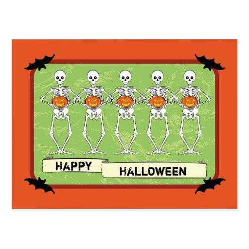 Skeletons holding pumpkins post cards