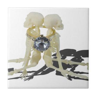 SkeletonsChokedByEngagementRing070515 Small Square Tile
