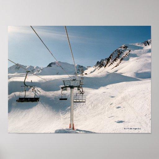 ski lift in sunny snowy landscape poster