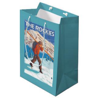 Skier Carrying Snow Skis - The Rockies Medium Gift Bag