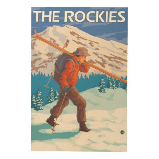 Skier Carrying Snow Skis - The Rockies Wood Wall Decor