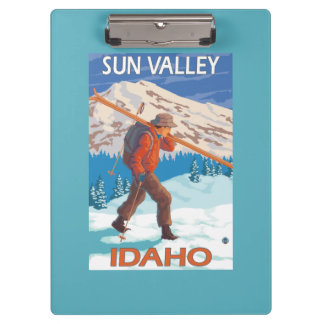 Skier Carrying Snow Skis- Vintage Travel 2 Clipboard