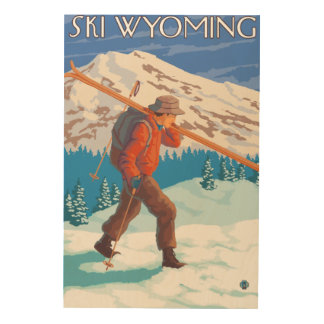 Skier Carrying Snow Skis - Wyoming Wood Print