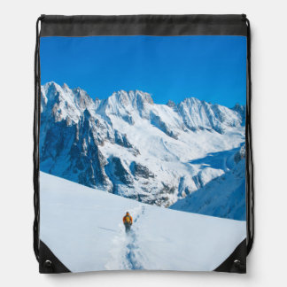 Skier on Snowy Mountain Vista Drawstring Backpacks
