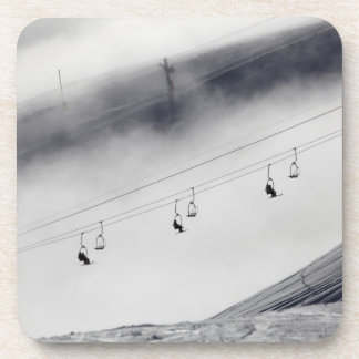 Skiers on a chair lift drink coaster