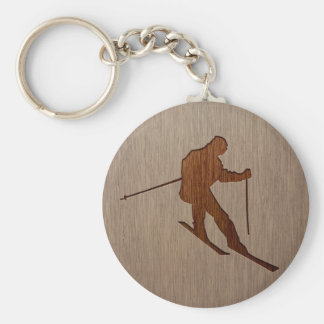 Skiing silhouette engraved on wood design basic round button key ring