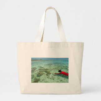 Skindiver swimming in a tropical sea canvas bags