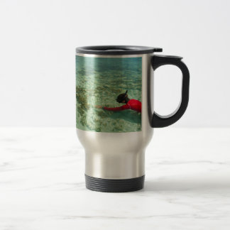 Skindiver swimming in a tropical sea stainless steel travel mug