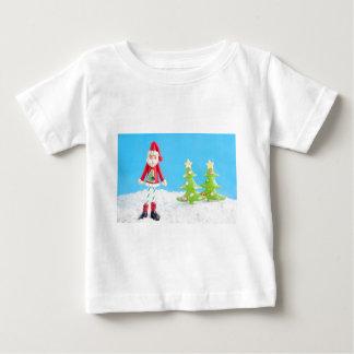 Skinny Santa Claus on snow Tee Shirts