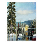Skis and Snowboards on Mountain Top Postcard