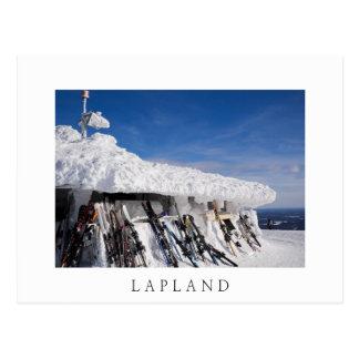 Skis in a ski resort, Lapland white text postcard