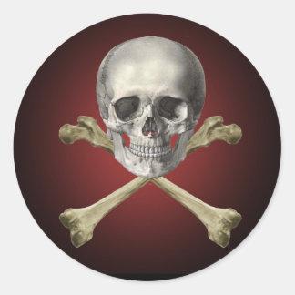 Skull and cross bones round sticker