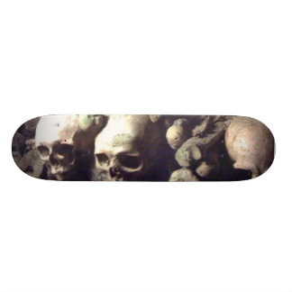 Skulls in a row skate board deck