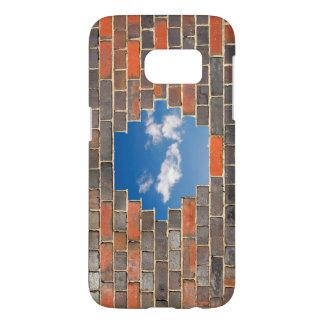 Sky through a hole in a brick wall