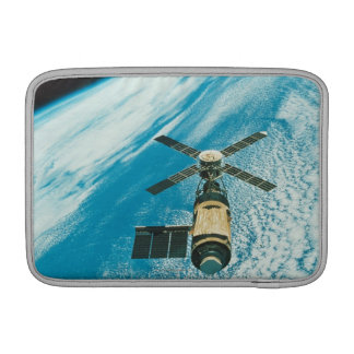 Skylab over Earth MacBook Sleeve