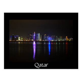 Skyline of Doha, Qatar at night black postcard