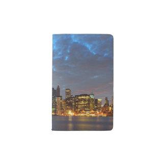 Skyline view of city in night. pocket moleskine notebook