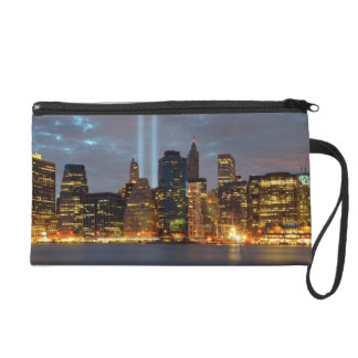 Skyline view of city in night. wristlet