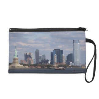 Skyline with Statue of Liberty Wristlet Purses