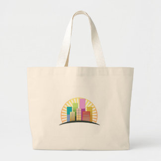 Skyscrapers and sun showing a urban city jumbo tote bag