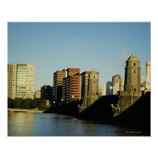 Skyscrapers near a bridge across a river, poster