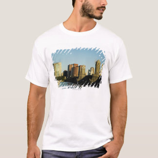Skyscrapers near a bridge across a river, T-Shirt