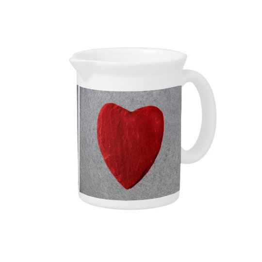 Slate background with heart beverage pitcher