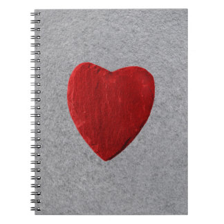 Slate background with heart notebooks