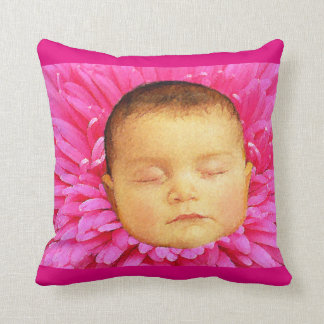 Sleeping baby on a flower throw pillow. cushions