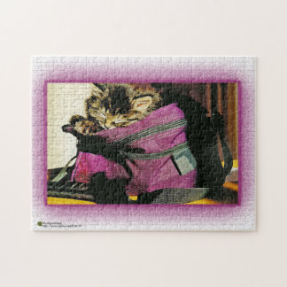 Sleeping Kitten In A Burgundy Purse Jigsaw Puzzle