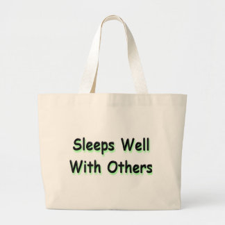 Sleeps well with others tote bags