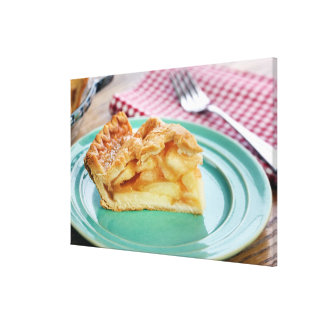 Slice of fresh baked apple pie on plate canvas print