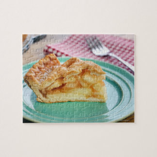 Slice of fresh baked apple pie on plate jigsaw puzzle